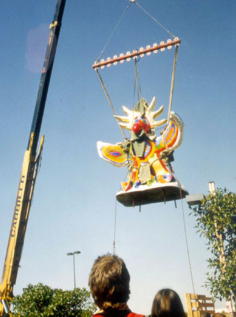Sun god being lowered by a crane old photo