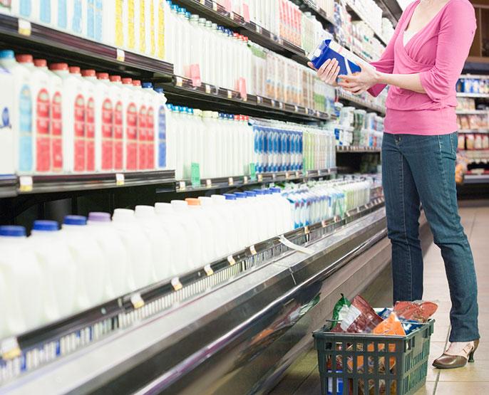 woman in milk aisle, supermarket