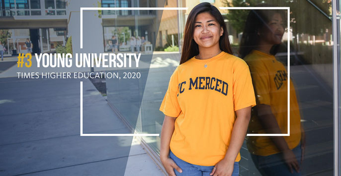 Times Higher Ed UC Merced ranking text with student standing outside in UC Merced T-shirt next to it