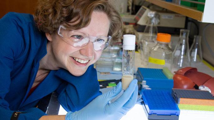 UC Davis' Kassandra Ori-McKenney holds a pipette