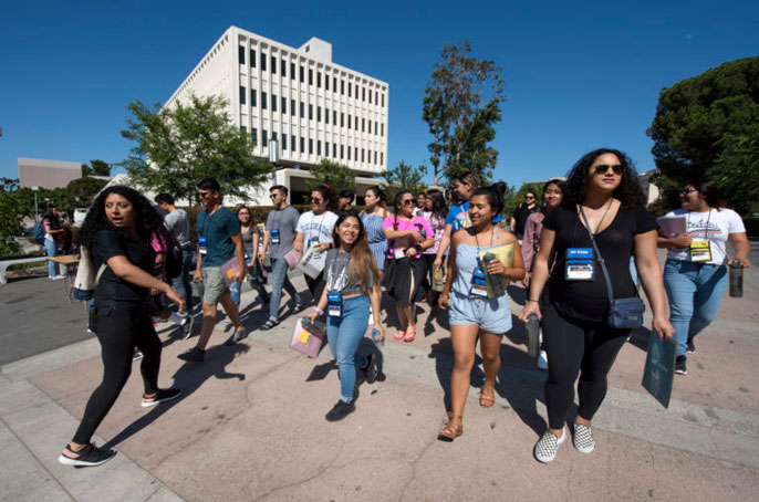 Students walking on the UC Irvine campus