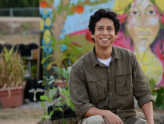 Fortino Morales III manages R'Garden, UC Riverside's 3-acre community garden.