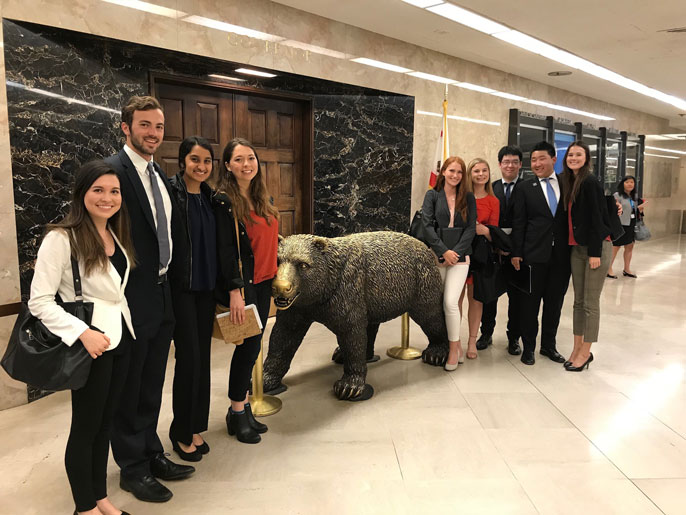 UCAN students next to bear statue in Sacramento