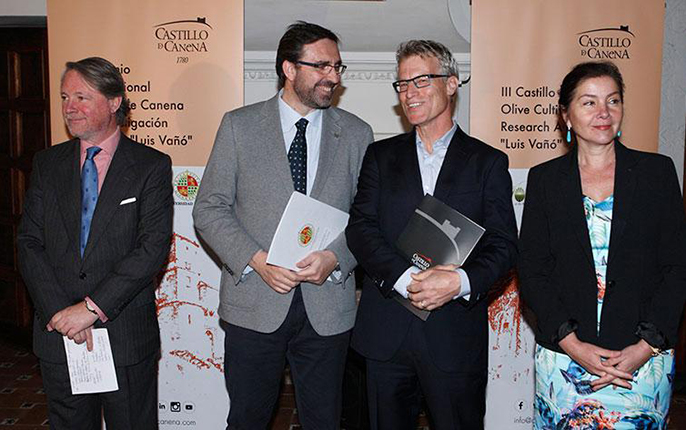 The UC Davis Olive Center's Dan Flynn, second from right, stands alongside Juan Gómez, rector of the University of Jaén, during the award ceremony in Castillo de Canena, the castle after which the olive oil company is named. Also pictured are company owne