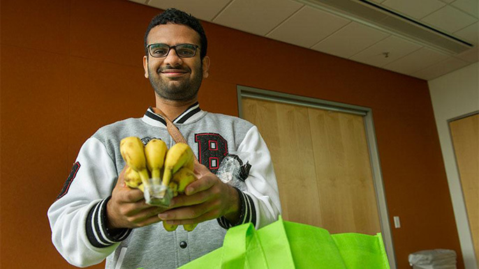 UC Davis graduate student Priyesh Shetty uses the free produce from the Fruit and Veggie Up! program to supplement his diet.