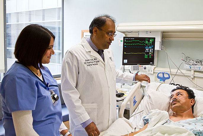 Dr. Alpesh Amin (center) with medical staffer and patient