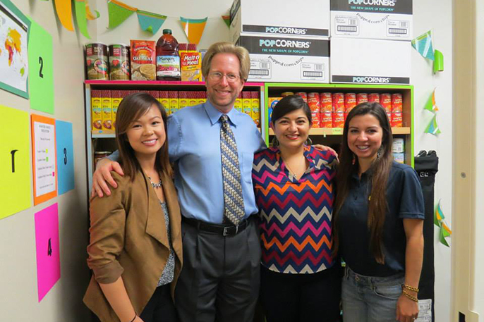 Standing inside the food pantry at UCI's Student Outreach & Retention Center are (from left) ASUCI food security Co-commissioner Erica Wong, Orange County Food Bank Director Mark Lowry, SOAR Director Graciela Fernandez and ASUCI food security Co-commissio