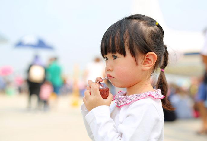 Child holding a juice box