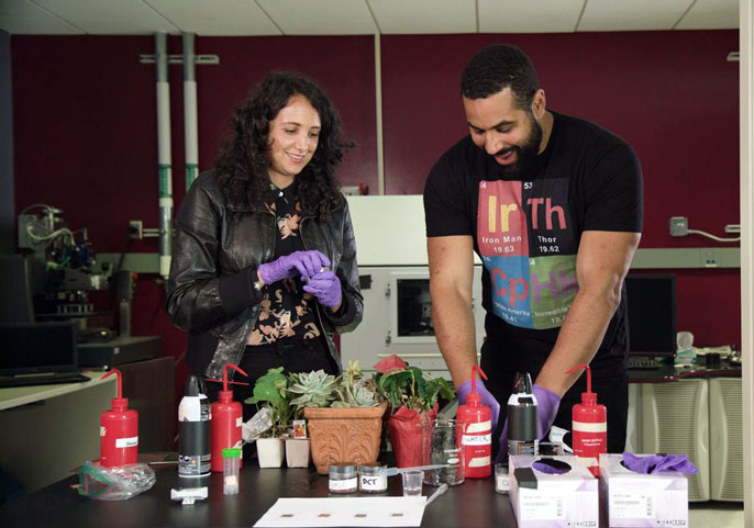 A man and a woman conduct a scientific experiment
