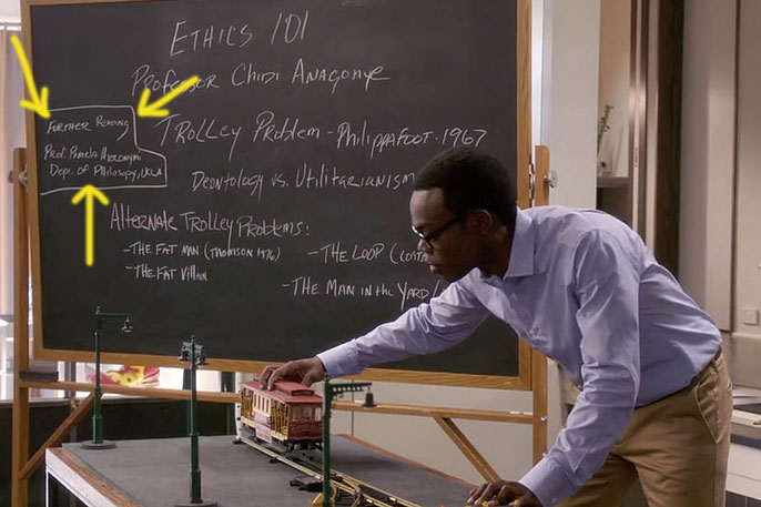 A character plays with a toy trolley in The Good Place