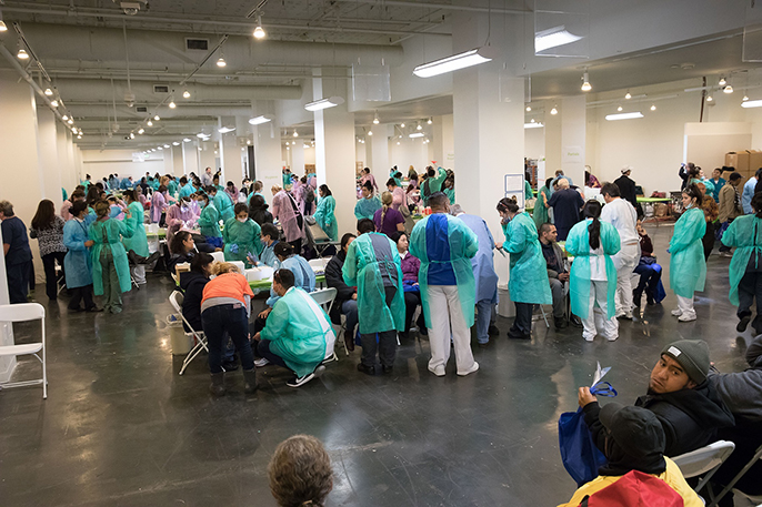 Volunteer dentists treat some of the 1,200 patients who received cleanings, fillings, extractions, partial dentures, root canals and oral cancer screenings at the 2017 Care Harbor Clinic.