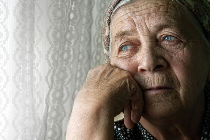 pensive elderly woman