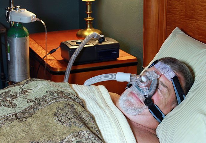 man with CPAP machine