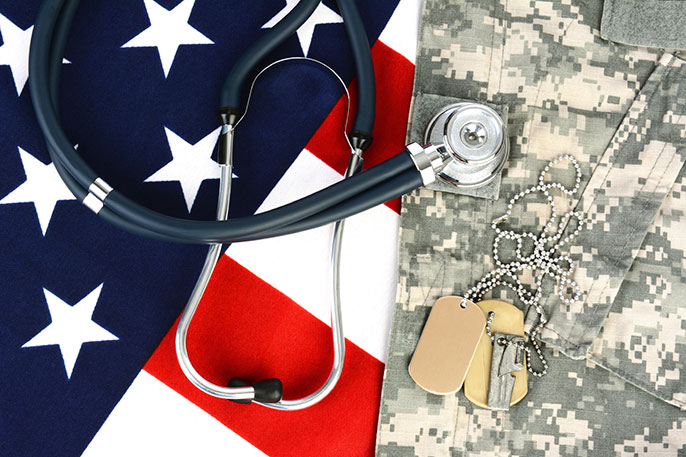 photo illustration: US flag, military fatigues, dog tags, stethoscope