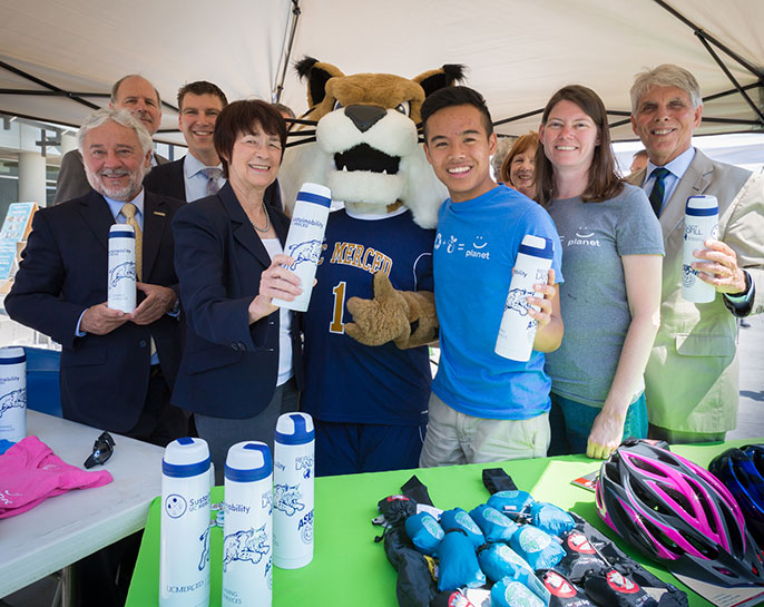 UC Global Food Initiative student fellow Hoaithi Dang (right of mascot) is one of three UC Merced students selected to speak at the upcoming session of Clinton Global Initiative University.