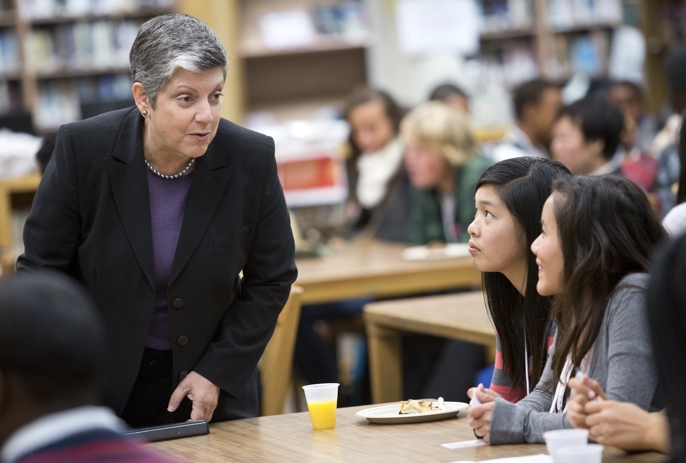 President Napolitano speaking to two students at Oakland Tech