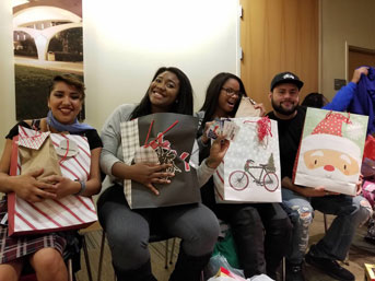 Guardian Scholars show off their Christmas gifts