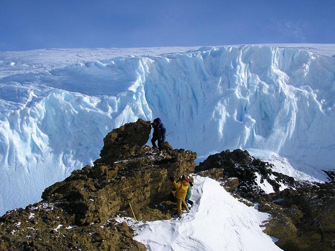 climbing rocks for samples - Antarctica