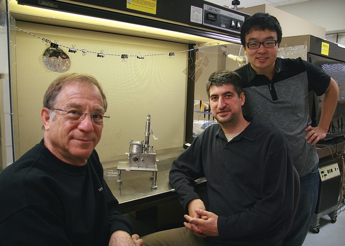 3 scientists sitting in a lab