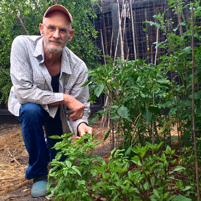 UC Santa Barbara professor David Cleveland in his home garden.