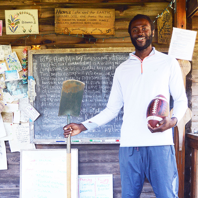 Former NFL defensive end Kalimba Edwards traded a mansion for a tent cabin on the UC Santa Cruz Farm where he is an apprentice in the ecologial horticulture program.