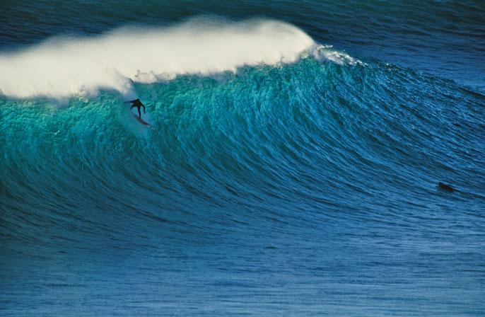 Surfer surfing on a big wave