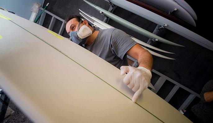Worker prepares world's first algae surfboard