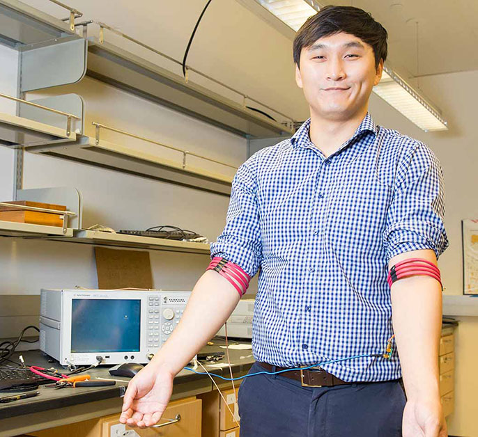 student with magnetic field armband prototype