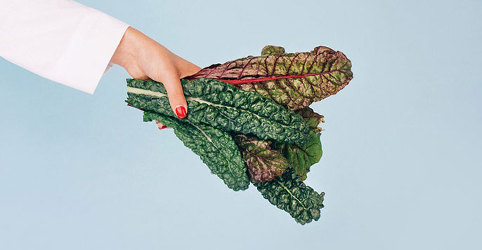 A doctor holding kale