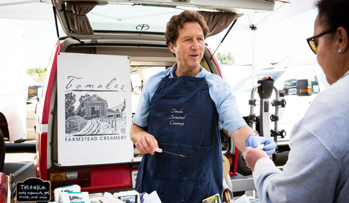 David Jablons, chief of thoracic surgery at UCSF Medical Center, sells his cheeses at the San Francisco Ferry Building farmers market on weekends.