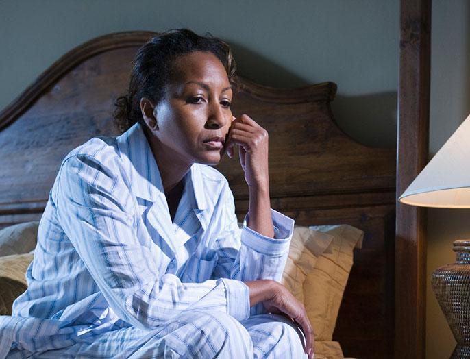 sad woman in pajamas