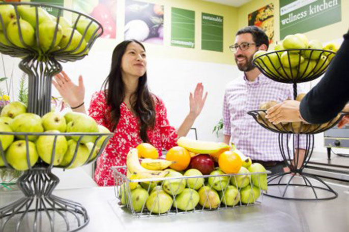Rita Nguyen, MD, and student Jacob Mirsky show off the future food pantry in the Community Wellness Center of San Francisco General Hospital and Trauma Center. Mirsky received a grant to support the project from the UC Global Food Initiative.