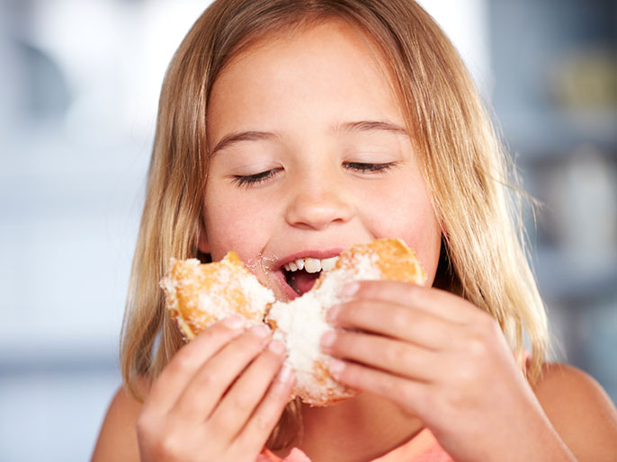 girl with sugared donut