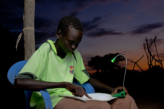 student and solar-powered light