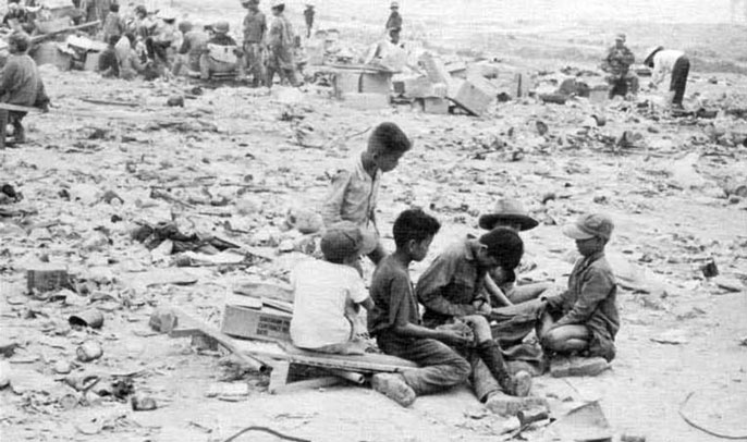 Vietnam devastation kids in the rubble