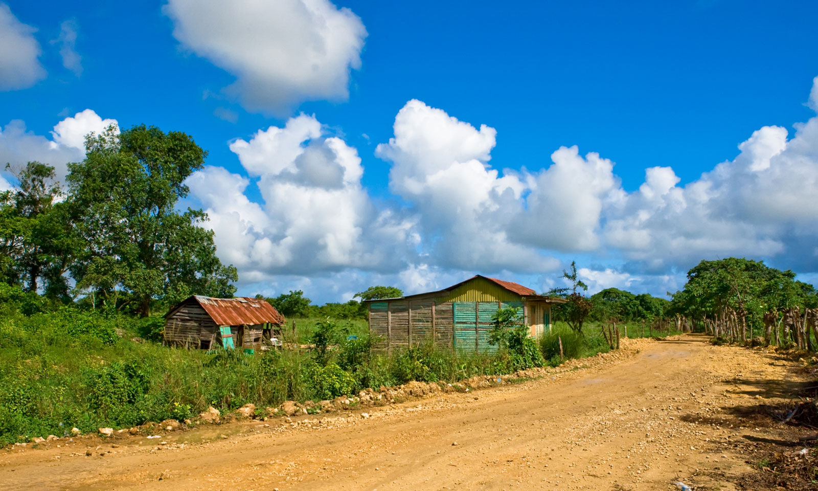 Two small homes near a dirt road