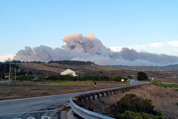 Cloud from a wildfire over a hill near Santa Cruz