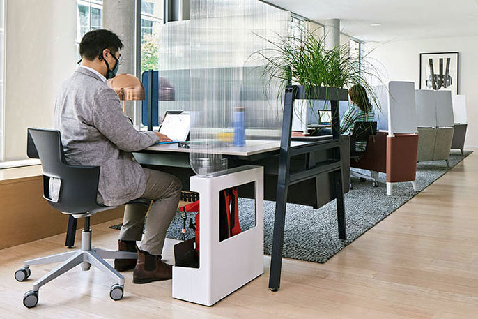 Man working in airy cubicle