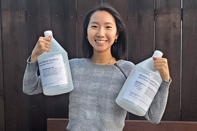 Yvonne Hao with the hand sanitizer she helped produce